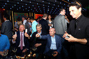 Magician Julius Dein performs in front of Laureus Academy Member Boris Becker and Arsene Wenger during the Laureus Academy Welcome Reception on February 17, 2019 in Monaco, Monaco.