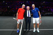 Denis Shapovalov of Team World, Rod Laver and Dominic Thiem of Team Europe pose for a photo after the coin toss prior to the start of the first match on Day One of the Laver Cup 2019 at Palexpo on September 20, 2019 in Geneva, Switzerland. The Laver Cup will see six players from the rest of the World competing against their counterparts from Europe. Team World is captained by John McEnroe and Team Europe is captained by Bjorn Borg. The tournament runs from September 20-22.