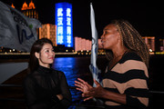 Venus Williams of USA and Li Na of China chat while posing for photos on the Yangzi river on Day 2 of 2019 Dongfeng Motor Wuhan Open at Optics Valley International Tennis Center on September 22, 2019 in Wuhan, China.