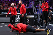 Team World Nick Kyrgios of Australia and Team World Frances Tiafoe of the United States do push-ups during the Men's Singles match between Team World Diego Schwartzman of Argentina and Team Europe David Goffin of Belgium on day one of the 2018 Laver Cup at the United Center on September 21, 2018 in Chicago, Illinois.
