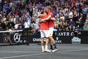 Team World Jack Sock of the United States and Team World Kevin Anderson of South Africa celebrate after defeating Team Europe Novak Djokovic of Serbia Team Europe Roger Federer of Switzerland in their Men's Doubles match on day one of the 2018 Laver Cup at the United Center on September 21, 2018 in Chicago, Illinois.
