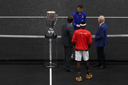 Team Europe Grigor Dimitrov of of Bulgaria and Team World Frances Tiafoe of the United States pose with former tennis player Rod Laver of Australia prior to their Men's Singles match on day one of the 2018 Laver Cup at the United Center on September 21, 2018 in Chicago, Illinois.