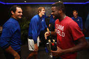 Team Worlds Frances Tiafoe talks with Roger Federer of Team Europe as Europe celebrate victory in the locker room after winning the Laver Cup at the United Center on September 23, 2018 in Chicago, Illinois.The Laver Cup consists of six players from the rest of the World competing against their counterparts from Europe.John McEnroe will captain the Rest of the World team and Europe will be captained by Bjorn Borg. The event runs from 21-23 Sept.