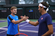 David Goffin of  Team Europe meets with team mate Roger Federer prior to his practice session prior to the Laver Cup at the United Center on September 18, 2018 in Chicago, Illinois.The Laver Cup consists of six European players competing against their counterparts from the rest of the World. Europe will be captained by Bjorn Borg and John McEnroe will captain the Rest of the World team. The event runs from 21-23 Sept.