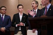 Marjory Stoneman Douglas High School shooting survivor David Hogg (2nd L) jots notes on his hand as he joins a news conference with (L-R) Rep. Salud Carbajal (D-CA), Los Angeles City Attorney Mike Feuer and Sen. Richard Blumenthal (D-CT) in the U.S. Capitol Visitors Center March 22, 2018 in Washington, DC. Organized by the Brady Campaign to Prevent Gun Violence and Prosecutors Against Gun Violence, the participants outlined their three-point legislative plan to curb gun violence just days before the March For Our Lives.
