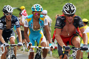 Lance Armstrong of the USA and Team Radioshack leads Alberto Contador of Spain and the Astana Team and Andy Schleck of Luxembourg and Team Saxo Bank during stage seven of the 2010 Tour de France from Tournus to Station des Rousses on July 10, 2010 in Station des Rousses, France.