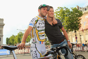 Mark Cavendish (L) of team HTC Columbia poses for photographs with teammate Mark Renshaw after the twentieth and final stage of Le Tour de France 2010, from Longjumeau to the Champs-Elysees in Paris on July 25, 2010 in Paris, France.