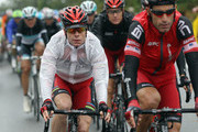 Cadel Evans of Australia and the BMC Racing Team rides alongside team mate George Hincapie of the USA in the peloton during stage four of the 2011 Tour de France from Lorient to Mur-de-Bretagne on July 5, 2011 in Bretagne, France.