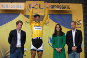 Overall race leader Marcel Kittel of Germany and Team Giant-Shimano is presented by Prince Harry (L), Catherine, Duchess of Cambridge and Prince William, Duke of Cambridge (R) after Kittel won stage one of the 2014 Tour de France from Leeds to Harrogate on July 5, 2014 in Harrogate, United Kingdom.