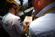 Michal Kwiatkowski of Poland riding for Team Sky signs a poster during stage 19 of the 2017 Le Tour de France, a 222.5km stage from Embrun to Salon-de-Provence on July 21, 2017 in Embrun, France.