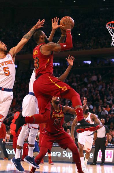 Cleveland Cavaliers v New York Knicks [photograph,basketball,basketball moves,sports,basketball player,team sport,ball game,player,basketball court,tournament,lebron james,user,user,courtney lee,note,basket,half,cleveland cavaliers,new york knicks]