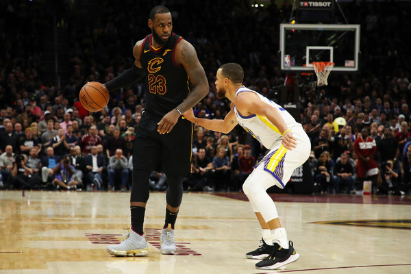 2018 NBA Finals - Game Three [photograph,sports,tournament,basketball player,ball game,player,sport venue,basketball moves,team sport,basketball,basketball court,lebron james,user,user,stephen curry,game,note,nba,cleveland cavaliers,finals]