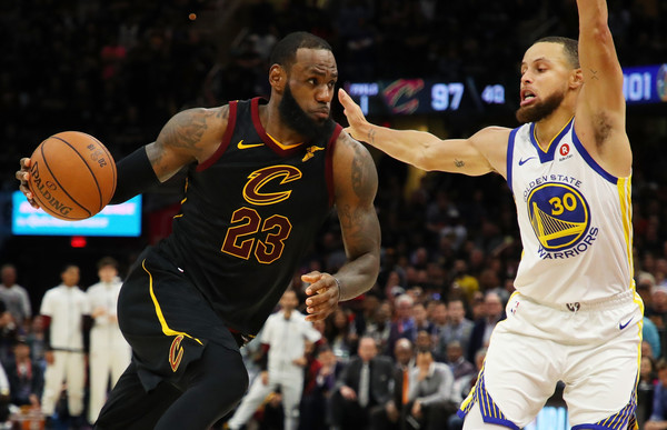 2018 NBA Finals - Game Three [photograph,basketball,player,basketball moves,sports,basketball player,basketball court,team sport,ball game,sport venue,lebron james,user,user,stephen curry,game,note,nba,cleveland cavaliers,finals]