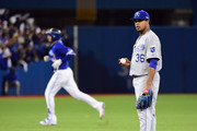 Edinson Volquez #36 of the Kansas City Royals reacts as Chris Colabello #15 of the Toronto Blue Jays runs the bases after hitting a solo home run in the second inning during game five of the American League Championship Series at Rogers Centre on October 21, 2015 in Toronto, Canada.