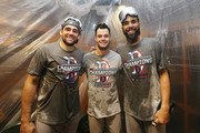 (L-R) Nathan Eovaldi #17; Joe Kelly #56 and David Price #24 of the Boston Red Sox pose in the clubhouse after defeating the Houston Astros 4-1 in Game Five of the American League Championship Series to advance to the 2018 World Series at Minute Maid Park on October 18, 2018 in Houston, Texas.