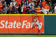A fan interferes with Mookie Betts #50 of the Boston Red Sox as he attempts to catch a ball hit by Jose Altuve #27 of the Houston Astros (not pictured) in the first inning during Game Four of the American League Championship Series at Minute Maid Park on October 17, 2018 in Houston, Texas.