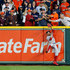 Charlie Morton Photos - A fan interferes with Mookie Betts #50 of the Boston Red Sox as he attempts to catch a ball hit by Jose Altuve #27 of the Houston Astros (not pictured) in the first inning during Game Four of the American League Championship Series at Minute Maid Park on October 17, 2018 in Houston, Texas. - League Championship Series - Boston Red Sox vs. Houston Astros - Game Four