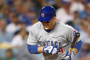 Anthony Rizzo #44 of the Chicago Cubs reacts after getting hit by a pitch in the ninth inning during Game Two of the National League Championship Series against the Los Angeles Dodgers at Dodger Stadium on October 15, 2017 in Los Angeles, California.