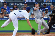 Jon Lester #34 of the Chicago Cubs falls down as he attempts to bunt in the third inning against the Los Angeles Dodgers during game two of the National League Championship Series at Dodger Stadium on October 15, 2017 in Los Angeles, California.