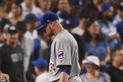 Jon Lester #34 of the Chicago Cubs walks to the dugout in the fifth inning against the Los Angeles Dodgers during game two of the National League Championship Series at Dodger Stadium on October 15, 2017 in Los Angeles, California.