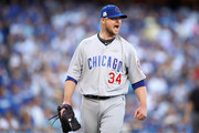 Jon Lester #34 of the Chicago Cubs reacts after the last out of the third inning during Game Two of the National League Championship Series against the Los Angeles Dodgers at Dodger Stadium on October 15, 2017 in Los Angeles, California.