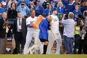 Salvador Perez #13 of the Kansas City Royals douses Eric Hosmer #35 of the Kansas City Royals after defeating the Toronto Blue Jays 6-3 in game two of the American League Championship Series at Kauffman Stadium on October 17, 2015 in Kansas City, Missouri.