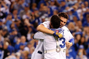 Eric Hosmer #35  and Salvador Perez #13 of the Kansas City Royals celebrate after the Royals 4-3 victory against the Toronto Blue Jays in game six of the 2015 MLB American League Championship Series at Kauffman Stadium on October 23, 2015 in Kansas City, Missouri.