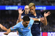 Bruno Fornaroli of Melbourne City controls the ball infront of Keisuke Honda of the Victory during the round one A-League match between Melbourne Victory and Melbourne City at Marvel Stadium on October 20, 2018 in Melbourne, Australia.