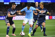 Bruno Fornaroli of Melbourne City controls the ball infront of Nicholas Ansell and Keisuke Honda of the Victory during the round one A-League match between Melbourne Victory and Melbourne City at Marvel Stadium on October 20, 2018 in Melbourne, Australia.