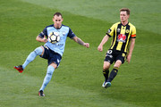 Luke Wilkshire of Sydney FC controls the ball under pressure from Michael McGlinchey of the Phoenix during the round 12 A-League match between the Wellington Phoenix and Sydney FC at Westpac Stadium on December 23, 2017 in Wellington, New Zealand.