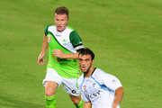 Bruno Cazarine of Sydney passes the bal away from Ufuk Talay of the Fury during the round 18 A-League match between the North Queensland Fury and Sydney FC at Dairy Farmers Stadium on December 15, 2010 in Townsville, Australia.