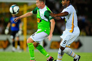 Ufuk Talay of the Fury contests the ball with Robson of United  during the round 27 A-League match between North Queensland Fury and Gold Coast United at Dairy Farmers Stadium on February 13, 2010 in Townsville, Australia.
