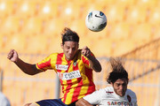 Stefano Ferrario (L) of Lecce competes for the ball in air with Joaquin Larrivey of Cagliari during the Serie A match between US Lecce and Cagliari Calcio at Stadio Via del Mare on October 2, 2011 in Lecce, Italy.