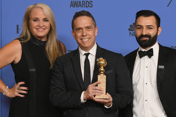 75th Annual Golden Globe Awards - Press Room [best motion picture,event,award,suit,formal wear,white-collar worker,tuxedo,darla k. anderson,lee unkrich,adrian molina,coco,l-r,room,press room,the beverly hilton hotel,golden globe awards]