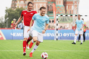 """Nuno Gomes (L) competes with Diego Forlan during the Legends Football Match in """"The park of Soccer and rest"""" at Red Square on July 11, 2018 in Moscow, Russia."""