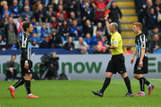 Daryl Janmaat (L) of Newcastle United is shown the red card by referee Mike Dean during the Barclays Premier League match between Leicester City and Newcastle United at The King Power Stadium on May 2, 2015 in Leicester, England.