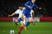 Jamie Vardy of Leicester Cty battles wth Samir Nasri of Seville during the UEFA Champions League Round of 16 second leg match between Leicester City and Sevilla FC at The King Power Stadium on March 14, 2017 in Leicester, United Kingdom.