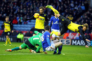 Watford's Joel Ekstrand clatters into his own keeper Manuel Almunia as Leicester City's David Nugent puts pressure on during the Sky Bet Championship match between Leicester City and Watford at The King Power Stadium on February 08, 2014 in Leicester, England.