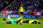 Watford's Joel Ekstrand clatters into his own keeper Manuel Almunia during the Sky Bet Championship match between Leicester City and Watford at The King Power Stadium on February 08, 2014 in Leicester, England.