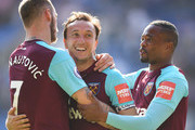 Mark Noble of West Ham United celebrates with team mates Marko Arnautovic and Patrice Evra after scoring his teams second goal during the Premier League match between Leicester City and West Ham United at The King Power Stadium on May 5, 2018 in Leicester, England.