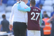 David Moyes, Manager of West Ham United is embraced by Patrice Evra of West Ham United after the Premier League match between Leicester City and West Ham United at The King Power Stadium on May 5, 2018 in Leicester, England.