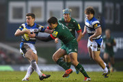 George Ford of Bath Rugby is tackled by Ben Youngs of Leicester Tigers during the Aviva Premiership match between Leicester Tigers and Bath Rugby at Welford Road on January 4, 2015 in Leicester, England.