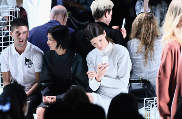 Lacoste - Front Row - Mercedes-Benz Fashion Week Spring 2014 [people,event,fashion,crowd,performance,photography,gesture,black hair,audience,hanneli mustaparta,geordon nicol,leigh lezark,lacoste - front row,l-r,lincoln center,new york city,lacoste,mercedes-benz fashion week,fashion show]