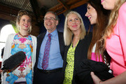 Len Brown celebrates with daughter (L-R) Victoria, wife Shan Inglis and daughters Olivia and Sam (R) his re-election as mayor of Auckland, defeating John Palino by 50,000 votes on October 12, 2013 in Auckland, New Zealand.