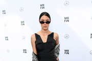 Rebecca Mir attends the Lena Hoschek show during the Berlin Fashion Week Spring/Summer 2019 at ewerk on July 3, 2018 in Berlin, Germany.
