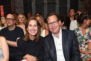Annette Weber and Robert Poelzer attend the Lena Hoschek show during the Berlin Fashion Week Spring/Summer 2019 at ewerk on July 3, 2018 in Berlin, Germany.