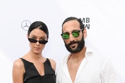 Rebecca Mir and husband Massimo Sinato attend the Lena Hoschek show during the Berlin Fashion Week Spring/Summer 2019 at ewerk on July 3, 2018 in Berlin, Germany.