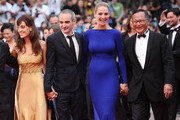 """(L-R) Jury Members Martina Gusman, Olivier Assayas,  Uma Thurman, and Johnnie To attend the """"Les Bien-Aimes"""" premiere at the Palais des Festivals during the 64th Cannes Film Festival on May 22, 2011 in Cannes, France."""
