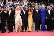 "(L-R) Jury Members Nansun Shi, Jury President Robert De Niro, Linn Ullmann, Mahamat-Saleh Haroun, Martina Gusman, Olivier Assayas,  Uma Thurman, and Johnnie To attend the ""Les Bien-Aimes"" premiere at the Palais des Festivals during the 64th Cannes Film Festival on May 22, 2011 in Cannes, France."