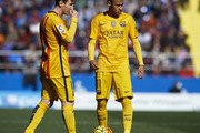 Lionel Messi of Barcelona talks with team mate Neymar JR (R) during the La Liga match between Levante UD and FC Barcelona at Ciutat de Valencia on February 07, 2016 in Valencia, Spain.